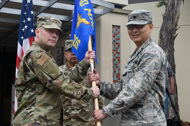 Col. Raymond Clydesdale, 30th Medical Group commander, transfers command of the newly activated 30th Health Care Operations Squadron to Lt. Col. Joseph Rountree, 30th HCOS commander, during the 30th MDG reorganization ceremony Aug. 23, 2019, at Vandenberg Air Force Base, Calif.