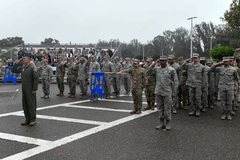 Airmen from the newly activated 30th Health Care Operations Squadron and redesignated 30th Operational Medical Readiness Squadron provide a presentation of the group during the 30th Medical Group reorganization ceremony Aug. 23, 2019, at Vandenberg Air Force Base, Calif.