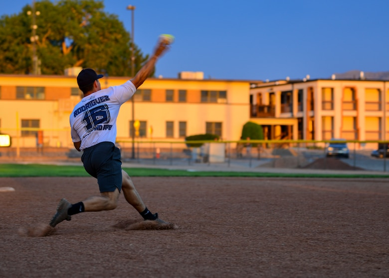 Gabe Rodriguez, third baseman for Team SFS, throws the softball to first base during the 2019 Kirtland Softball Intramural Championship Game at Kirtland Air Force Base, N.M., August 22, 2019. The championship game was a seven-inning game with Team AFRL beating Team SFS with a final score of 26-22. (U.S. Air Force photo by Airman 1st Class Austin J. Prisbrey)