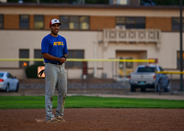 Marcus Mansfield, outfielder for Team AFRL, stands at second base during the 2019 Kirtland Softball Intramural Championship Game at Kirtland Air Force Base, N.M., August 22, 2019. The championship game was a seven-inning game with Team AFRL beating Team SFS with a final score of 26-22. (U.S. Air Force photo by Airman 1st Class Austin J. Prisbrey)