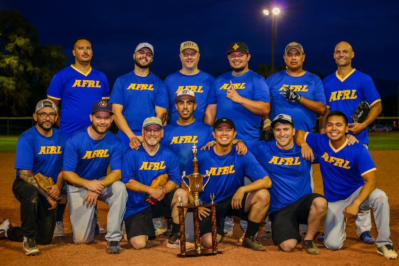 Team AFRL poses for a photo with the 2019 Kirtland Softball Intramural Championship trophy at Kirtland Air Force Base, N.M., August 22, 2019. Team AFRL beat Team SFS for the championship game with a final score of 26-22. (U.S. Air Force photo by Airman 1st Class Austin J. Prisbrey)