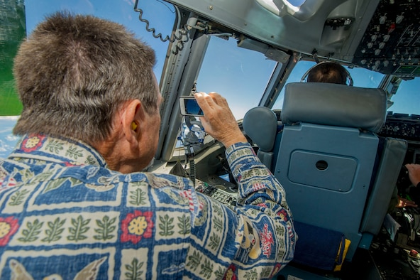 "Darrell Welch, a member of the Pacific Air Forces' Air Force Civilian Advisory Council, takes photos of an aerial refueling on board a C-17 Globemaster III assigned to the 535th Airlift Squadron, at Joint Base Pearl Harbor-Hickam, Hawaii, Aug. 20, 2019. Thirty-one AFCAC civic leaders attended a PACAF-hosted C-17 civic leader flight where they witnessed two refueling efforts by a KC-135 Stratofortress and one simulated C-17 cargo drop. Upon landing, AFCAC observed a heritage celebration for Staff Sgt. Ryan Myers and Maj. Freddy Rodriguez's ""fini"" flight. (U.S. Air Force photo by Staff Sgt. Jack Sanders)"