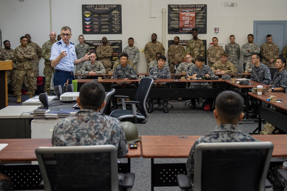 U.S. Air Force Col. David McCleese, 5th Air Force A4 director, speaks with the participants of Pacific Unity 2019 about the importance of the event prior to the classroom portion commencing at Yokota Air Base, Japan, August 20, 2019.