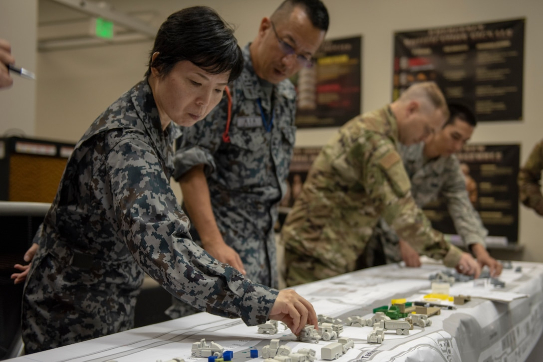 Japan Air Self-Defense Force and U.S. Air Force service members take part in the table top portion of Pacific Unity 2019 at Yokota Air Base, Japan, August 21, 2019.