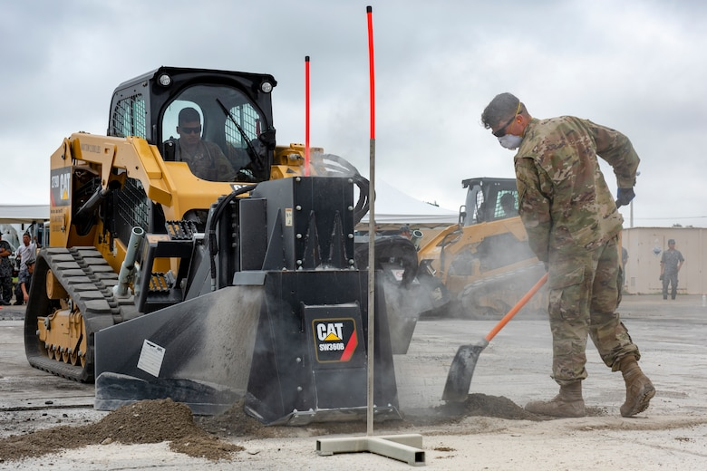 Senior Airman Tyler Crisp, 8th Civil Engineer Squadron electrical systems journeyman out of Kunsan Air Base, Republic of Korea, repositions dirt away from the equipment while conducting rapid airfield damage repair during Pacific Unity 2019 at Yokota Air Base, Japan, August 22, 2019.