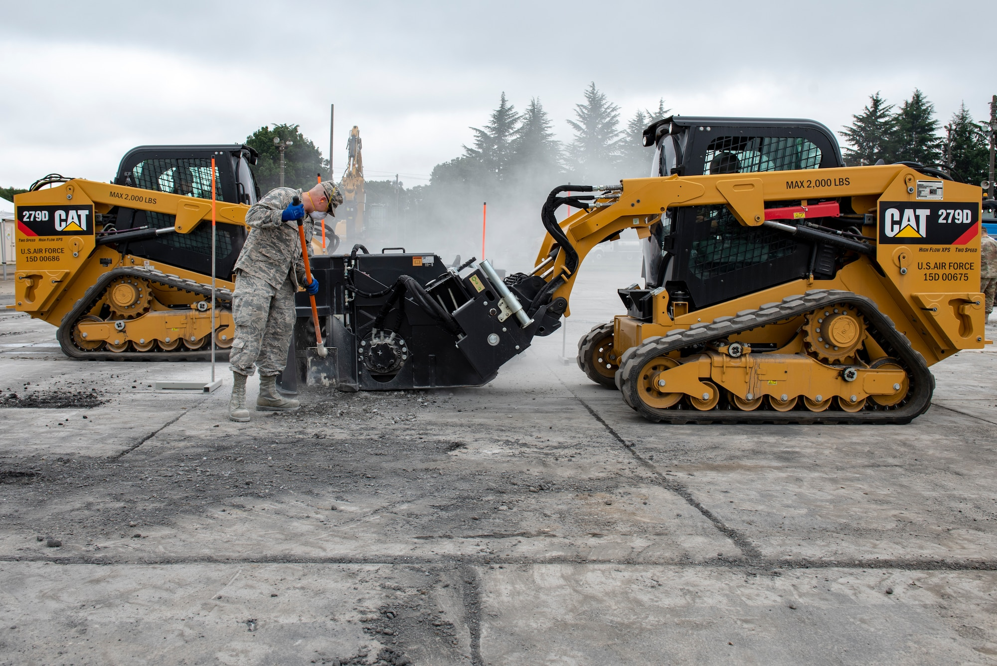 U.S. Air Force and the Japan Air Self-Defense Force (JASDF) civil engineers work together to cut a square around the simulated impact crater as part of rapid airfield damage repair (RADR) operations during Pacific Unity 2019 at Yokota Air Base, Japan, August 22, 2019.
