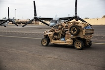 A U.S. Air Force para rescueman with Special Purpose Marine Air-Ground Task Force-Crisis Response-Africa 19.2, Marine Forces Europe and Africa, transports a utility -terrain vehicle on a flight line in Dakar, Senegal, Aug. 6, 2019. SPMAGTF-CR-AF 19.2 rehearsed embassy reinforcement procedures at U.S. Embassy Bamako, Mali. SPMAGTF-CR-AF is deployed to conduct crisis-response and theater-security operations in Africa and promote regional stability by conducting military-to-military training exercises throughout Europe and Africa. (U.S. Marine Corps photo by Cpl. Margaret Gale)