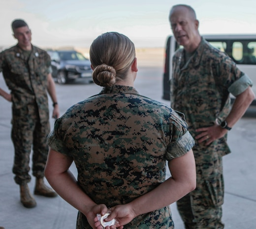 A U.S. Marine with Special Purpose Marine Air-Ground Task Force-Crisis Response-Africa 19.2 receives a command coin from Maj. Gen. Patrick J. Hermesmann, right, the commander of Marine Forces Europe and Africa, during a visit to Moron Air Base, Spain, Aug. 20, 2019. The Marine received the coin for her superior performance and dedication during the deployment. Hermesmann spoke with the deployed Marines and Sailors of SPMAGTF-CR-AF about their mission and role as a crisis response force. (U.S. Marine Corps photo by Cpl. Gumchol Cho)