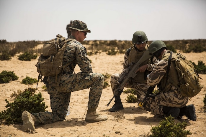 A U.S. Marine with Special Purpose Marine Air-Ground Task Force-Crisis Response-Africa 19.2, Marine Forces Europe and Africa, evaluates Moroccan soldiers during a culminating event at Tifnit, Morocco, July 25, 2019. The Moroccan Soldiers trained alongside the U.S. Marines and learned how to efficiently conduct infantry tactics. SPMAGTF-CR-AF is deployed to conduct crisis-response and theater-security operations in Africa and promote regional stability by conducting military-to-military training exercises throughout Europe and Africa. (U.S. Marine Corps photo by Cpl. Margaret Gale)