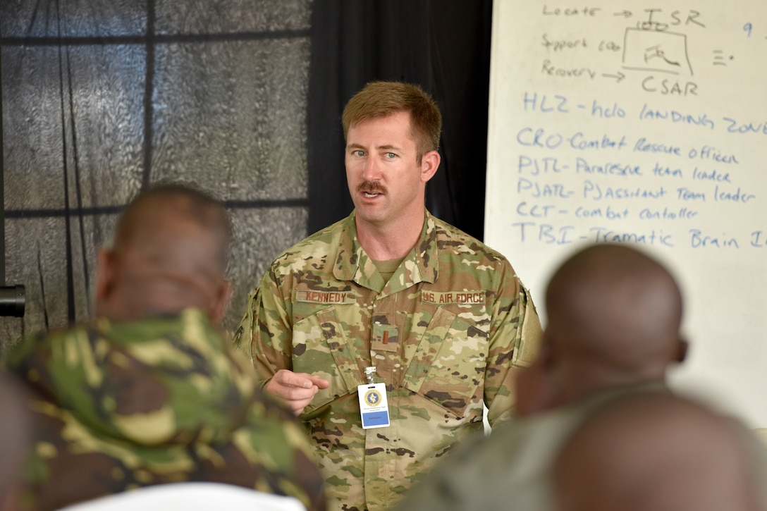 U.S. Air Force 2nd Lt. Michael Kennedy, 82nd Expeditionary Rescue Squadron combat rescue officer, shares best practices on casualty collection points during the African Partnership Flight Kenya 2019 event at Laikipia Air Base, Kenya, August 22, 2019.