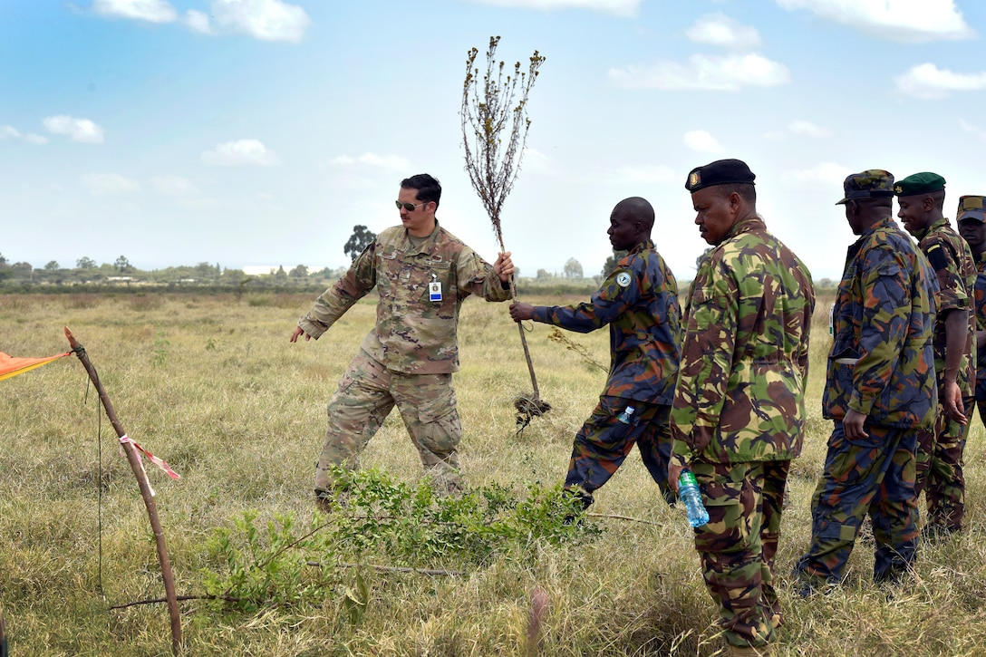 U.S. Air Force Tech. Sgt. Jared Todd, 818th Mobility Support Advisory Squadron Survival, Evasion, Resistance and Escape air advisor, demonstrates signaling techniques during African Partnership Flight Kenya 2019 at Laikipia Air Base, Kenya, August 22, 2019.