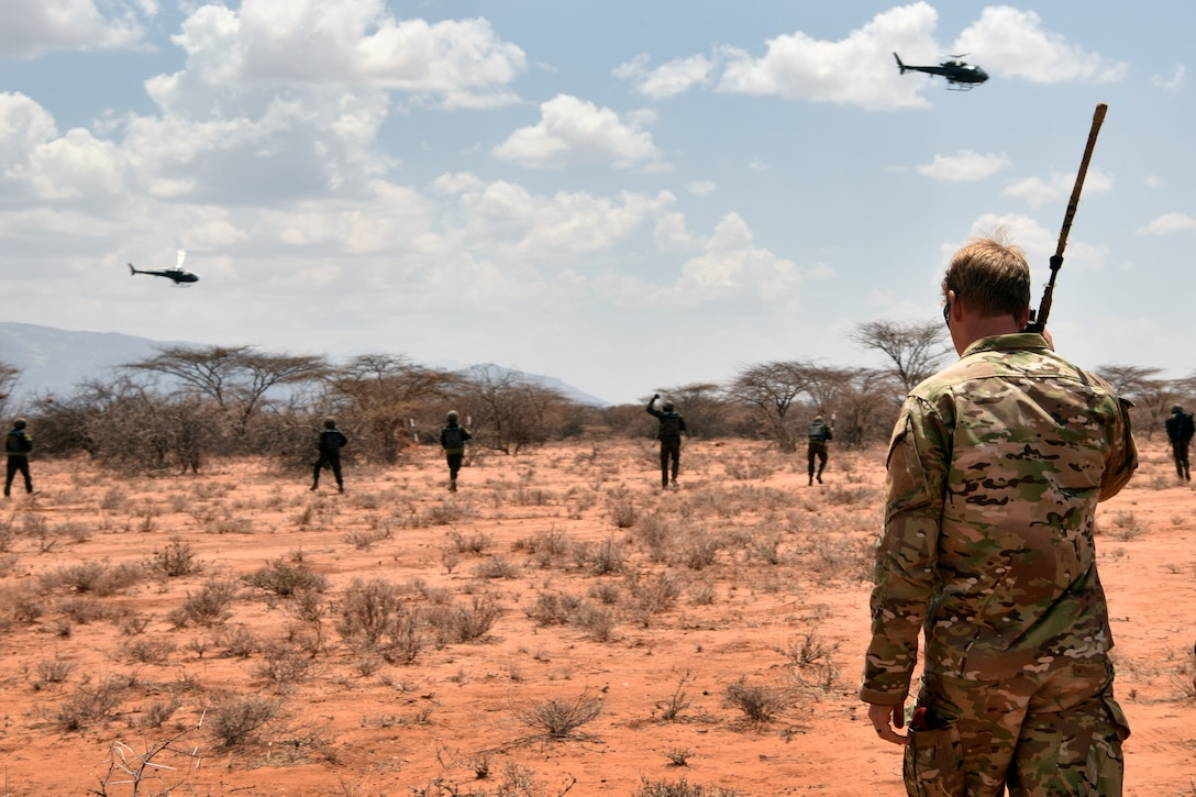 U.S. Air Force special tactics Airman with the 22nd Special Tactics Squadron observes the final demonstration of the African Partnership Flight Kenya 2019 program at Larisoro Air Strip, Kenya, August 25, 2019.