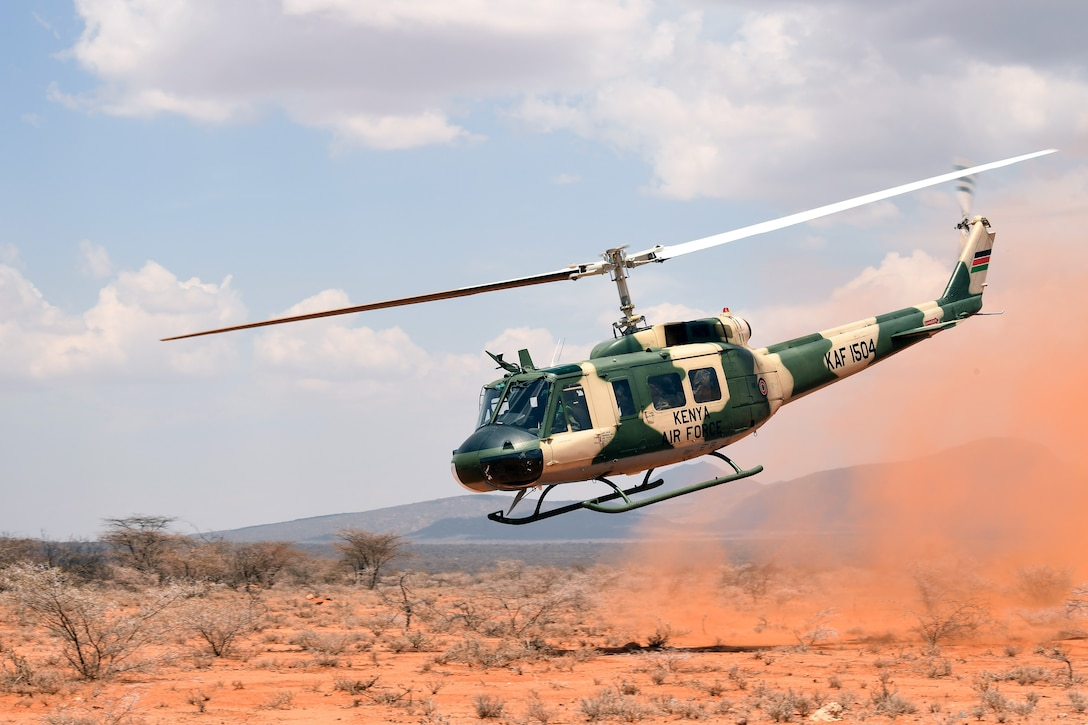 A Kenya air force UH-1 Huey takes off after rescuing a simulated isolated pilot during the final demonstration of African Partnership Flight Kenya 2019. Larisoro Air Strip, Kenya, August 24, 2019.