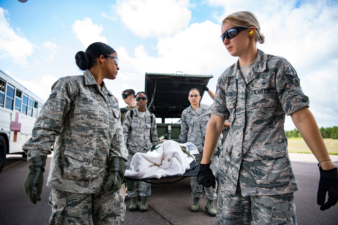 Airmen conduct a training scenario during Patriot Warrior 2019 at Fort McCoy, Wisconsin, Aug. 16, 2019. Patriot Warrior is Air Force Reserve Command's premier exercise, providing Airmen an opportunity to train with joint and international partners in airlift, aeromedical evacuation and mobility support. The exercise builds on capabilities for the future fight, increasing the readiness, lethality and agility of the Air Force Reserve. (U.S. Air Force Photo by Tech. Sgt. Gregory Brook)