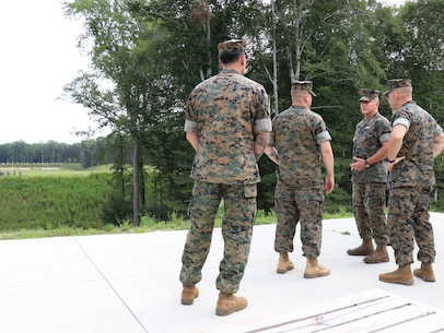 U.S. Marine Corps Gen. Robert F. Hedelund, the U.S. Marine Corps Forces Command commanding general, speaks to range personnel during a visit to Marine Corps Security Force Regiment (MCSFR) at Naval Weapons Station Yorktown, Virginia, Aug. 27, 2019. The leaders spoke about MCSFR's mission and capabilities as the largest Marine Corps regiment with 11 subordinate units in 8 locations throughout the world to include Bahrain, Cuba, Japan, and Spain. (U.S. Marine Corps photo by Sgt. Jessika Braden/ Released)