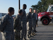 Lt. Col. Wayne Kinsel, 628th Civil Engineer Squadron commander, gives opening remarks during a push-in ceremony at Joint Base Charleston, S.C. Aug. 27, 2019. The push-in ceremony was a way for the Fire Department to welcome two new firetrucks to their fleet, a P-26 water tanker and a P-26 aerial apparatus, and was the first of its kind at JB Charleston. Push-in ceremonies date back to when firefighters responded with horses and carriages and pushed their carriages back into stalls after returning from a call.