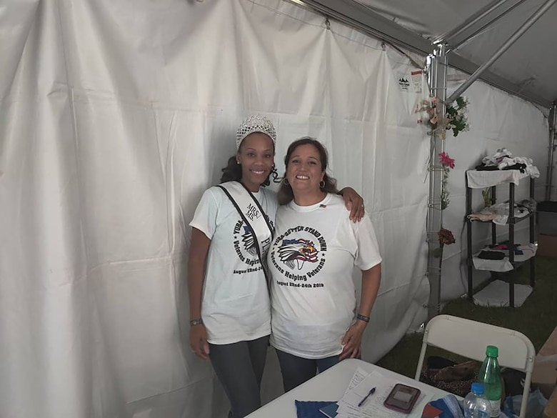 (Left to right) Staff Sgt. Breona Calvert, 50th Intelligence Squadron, commander's support staff, poses with Shannon Gaytan, coordinator of the Women's Tent and a veteran, as they prepare to service women in need during the Yuba Sutter 20th Year Stand Down event August 21-23 2019.