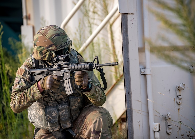 Master Sgt. Ryan Kegler, 3d Weather Squadron Det 1 section chief of division weather operations, fires an M4 Carbine during a certification field exercise (CFX), July 29, 2019, at Camp Bowie Training Center, Texas. The CFX was designed to evaluate the squadron's overall tactical ability and readiness to provide the U.S. Army with full spectrum environmental support to the Joint Task Force (JTF) fight. The CFX immersed Airmen into all the aspects of what could come with a deployment such as force on force scenarios. (U.S. Air Force photo by Airman 1st Class Eugene Oliver)