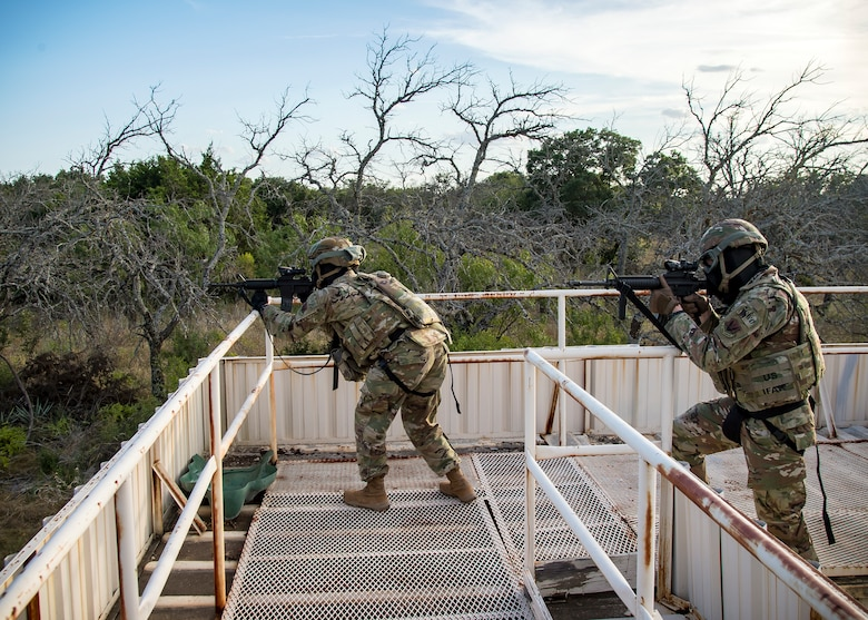 Staff Weather Officers from the 3d Weather Squadron, defend their position during a certification field exercise (CFX), July 29, 2019, at Camp Bowie Training Center, Texas. The CFX was designed to evaluate the squadron's overall tactical ability and readiness to provide the U.S. Army with full spectrum environmental support to the Joint Task Force (JTF) fight. The CFX immersed Airmen into all the aspects of what could come with a deployment such as force on force scenarios. (U.S. Air Force photo by Airman 1st Class Eugene Oliver)