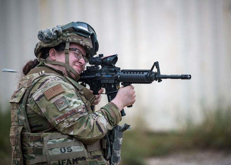 Airman 1st Class Elizabeth Cudnohufsky, 3d Weather Squadron weather forecaster fires an M4 carbine during a certification field exercise (CFX), July 30, 2019, at Camp Bowie Training Center, Texas. The CFX was designed to evaluate the squadron's overall tactical ability and readiness to provide the U.S. Army with full spectrum environmental support to the Joint Task Force (JTF) fight. The CFX immersed Airmen into all the aspects of what could come with a deployment such as force on force scenarios. (U.S. Air Force photo by Airman 1st Class Eugene Oliver)