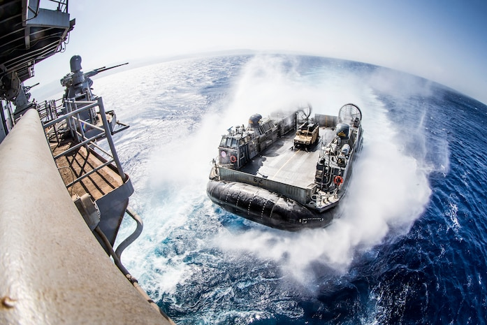A U.S. Navy landing craft, air cushion with Assault Craft Unit 5, prepares to enter the well deck of the amphibious assault ship USS Boxer, during an amphibious offload in support of exercise Eager Lion 2019. Eager Lion, U.S. Central Command's largest and most complex exercise, is an opportunity to integrate forces in a multilateral environment, operate in realistic terrain and strengthen military-to-military relationships.