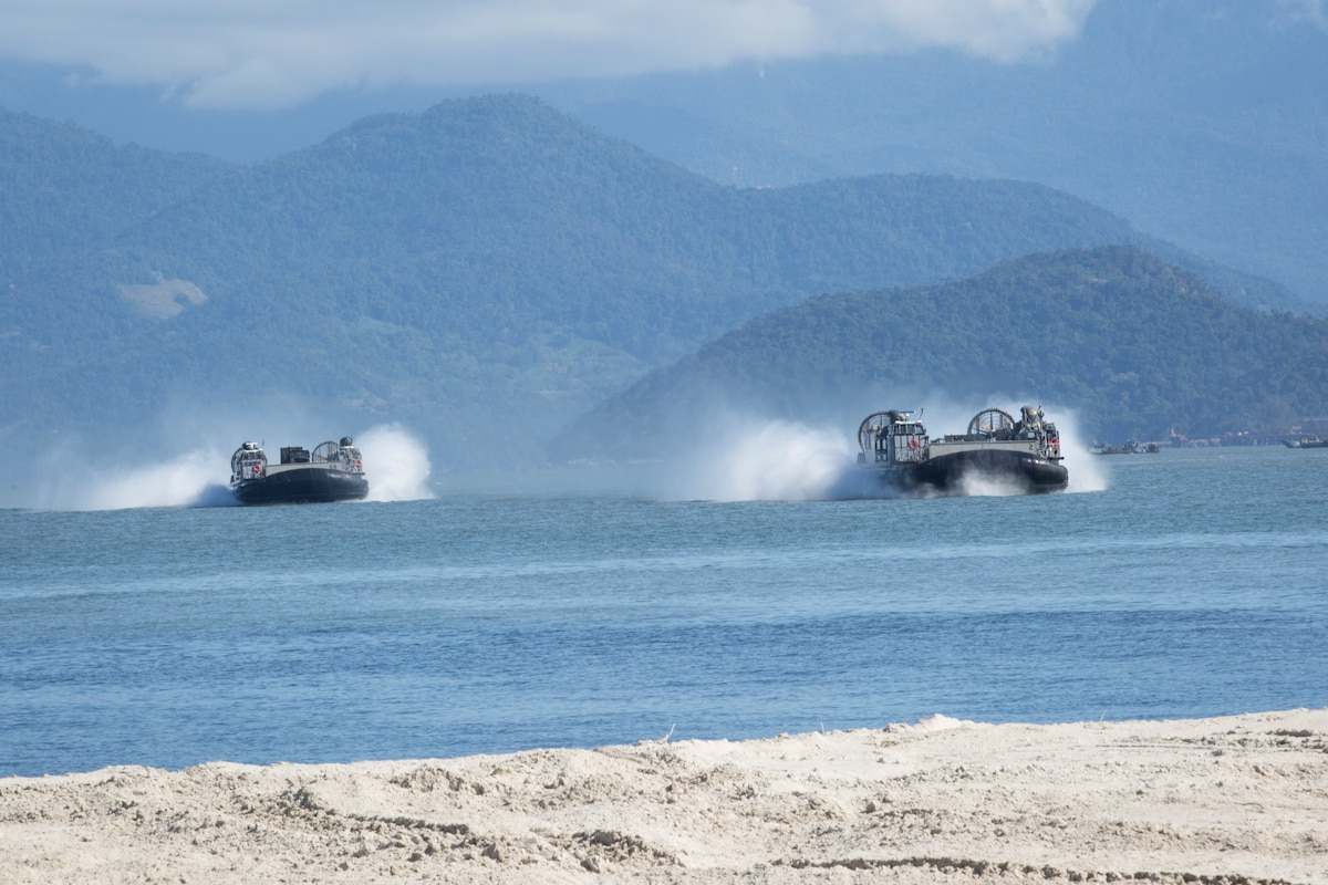 U.S. Navy Landing Craft Air Cushions conduct ship-to-shore operations.