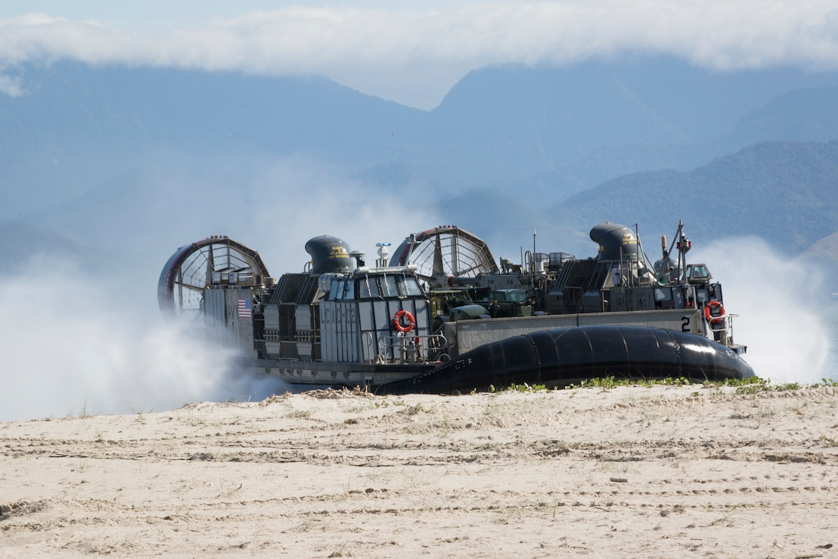 A U.S. Navy Landing Craft Air Cushion lands on shore.