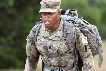Army Staff Sgt. Earnest J. Knight II, Drill Sergeant Academy, on a ruck march.