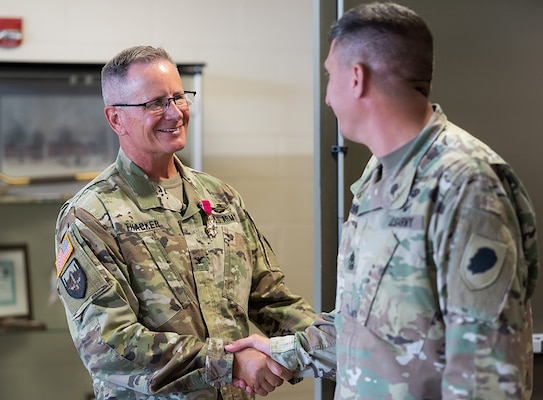 Friends congratulate Col. Rodney Thacker following his retirement ceremony, Aug. 23 at the Illinois Military Academy, Camp Lincoln, Springfield, Illinois.