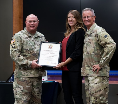 Maj. Gen. Michael R. Zerbonia, Assistant Adjutant General-Army, Illinois National Guard, presents April Thacker, wife of Col. Rodney Thacker with a Certificate of Appreciation
