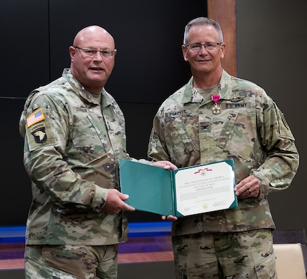 Maj. Gen. Michael R. Zerbonia, Assistant Adjutant General-Army, Illinois National Guard, presents Col. Rodney Thacker with the Legion of Merit.
