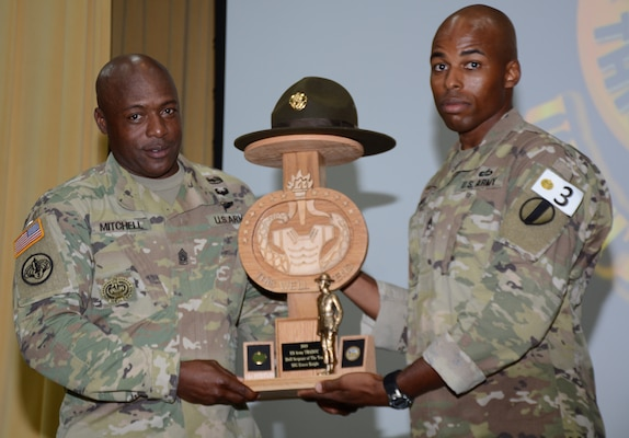 Command Sgt. Maj. Edward Mitchell, Center for Initial Military Training Command Sergeant Major (right), presents  Sgt. Earnest Knight II, Drill Sergeant Academy, with the Drill Sergeant of the Year award.