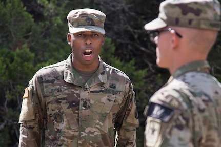 U.S. Army Staff Sgt. Earnest Knight II, U.S. Army Drill Sergeant Academy drill instructor, gives a soldier commands on the situational training exercise lanes during the Drill Sergeant of the Year Competition August 19, 2019, at Joint Base San Antonio-Camp Bullis.