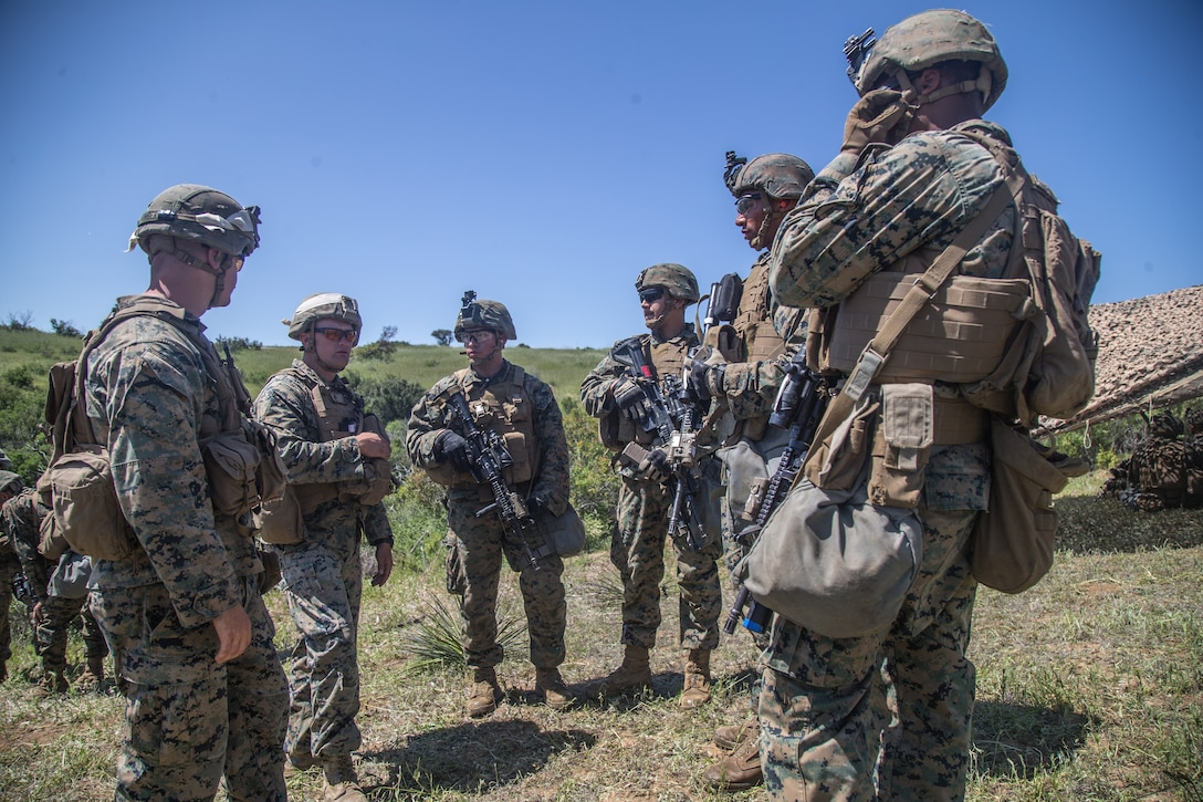 A group of Marines stand in a circle