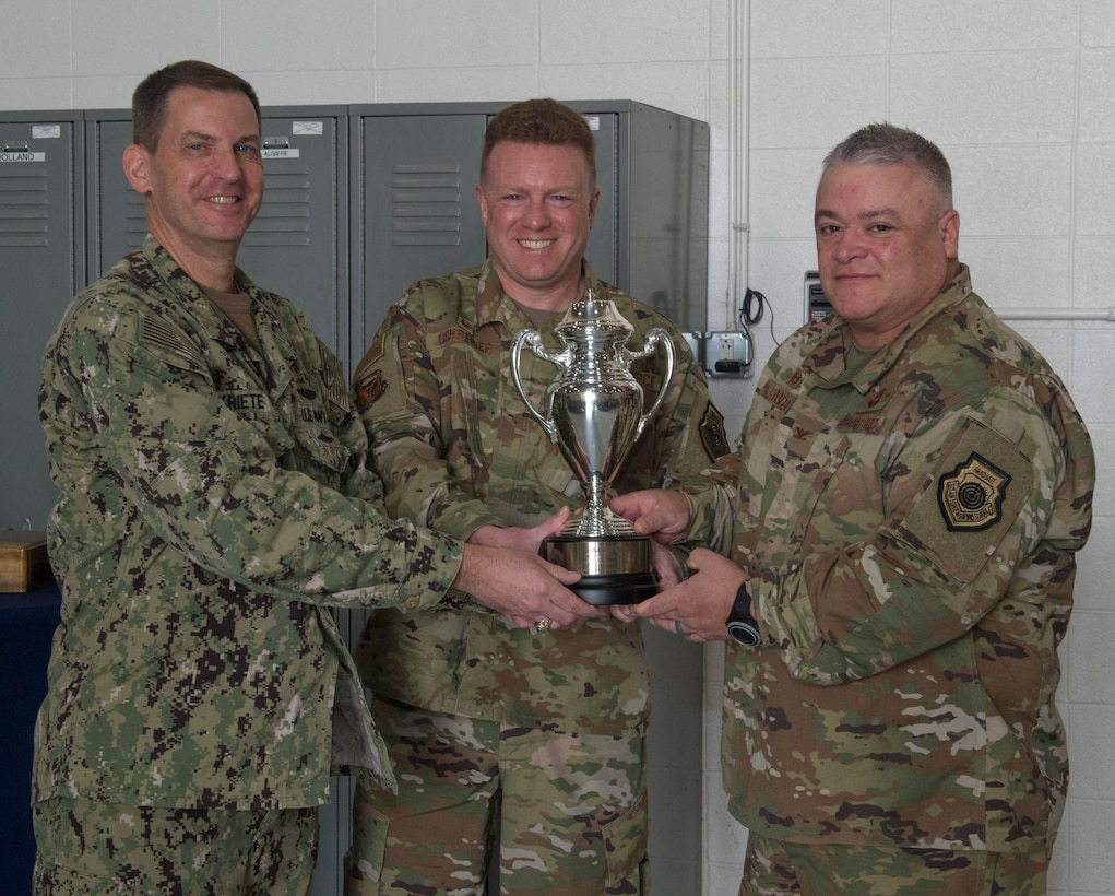 From left, U.S. Navy Vice Adm. Dave Kriete presents the Omaha Trophy to Col. Jeffrey Schreiner and Col. Kenneth Eaves on Aug. 27, 2019, at Whiteman Air Force Base, Missouri. The Omaha Trophy is awarded to units for excellence in strategic deterrence and support of global strike operations. The active-duty 509th Bomb Wing and Missouri Air National Guard's 131st Bomb Wing jointly earned the Omaha Trophy because of their interoperability to execute one of the country's most important national security missions: nuclear deterrence by utilizing the B-2 Spirit stealth bomber to deter adversaries and assure our allies. (U.S. Air Force Photo by Airman 1st Class Thomas Johns)