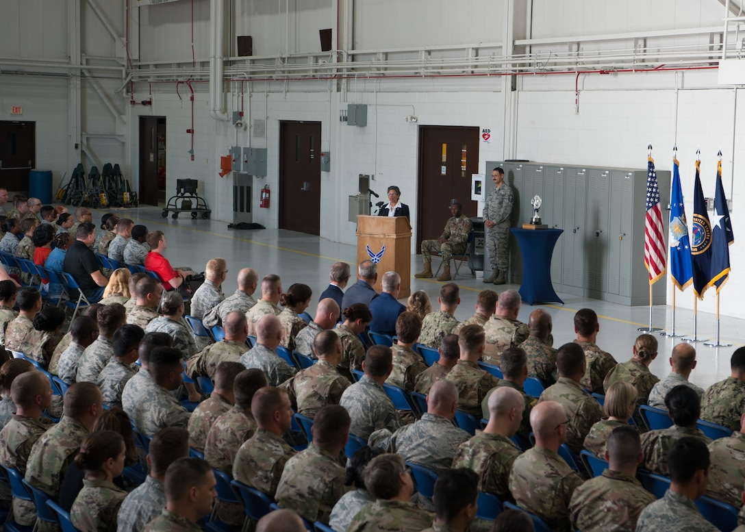 Rita Sanders, former mayor of Bellevue, Nebraska, speaks to Airmen of the 509th and 131st Bomb Wing during the Omaha Trophy Presentation Aug. 27, 2019, at Whiteman Air Force Base, Missouri. Sanders, a civic leaders from Omaha, represented the Strategic Command Consultation Committee – an advisory group comprising of business leaders who represent the people of the metropolitan Omaha area. (U.S. Air Force photo by Airman 1st Class Parker J. McCauley)