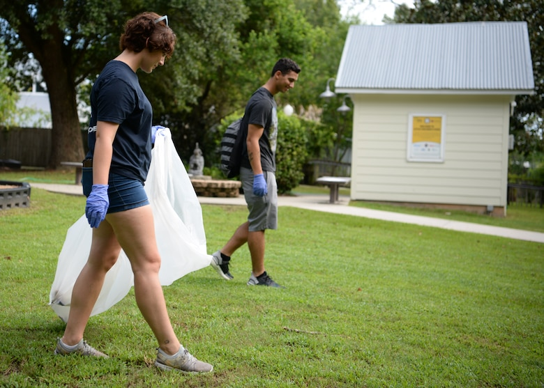 U.S Air Force Airman Mary-Charlotte McKean, 336th Training Squadron client systems student, looks for trash during the Community Clean-Up Day in Ocean Springs, Mississippi, Aug. 24, 2019. Volunteers coming from Ocean Springs and Keesler Air Force Base took to the streets of Ocean Springs to pick up trash around the city. (U.S Air Force photo by Airman 1st Class Spencer Tobler)
