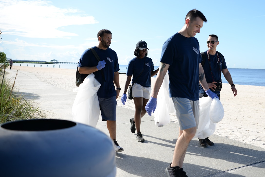 Volunteers from Keesler Air Force Base, look for trash during the Community Clean-Up Day in Ocean Springs, Mississippi, Aug. 24, 2019. Volunteers coming from Ocean Springs and Keesler Air Force Base took to the streets of Ocean Springs to pick up trash around the city. (U.S Air Force photo by Airman 1st Class Spencer Tobler)