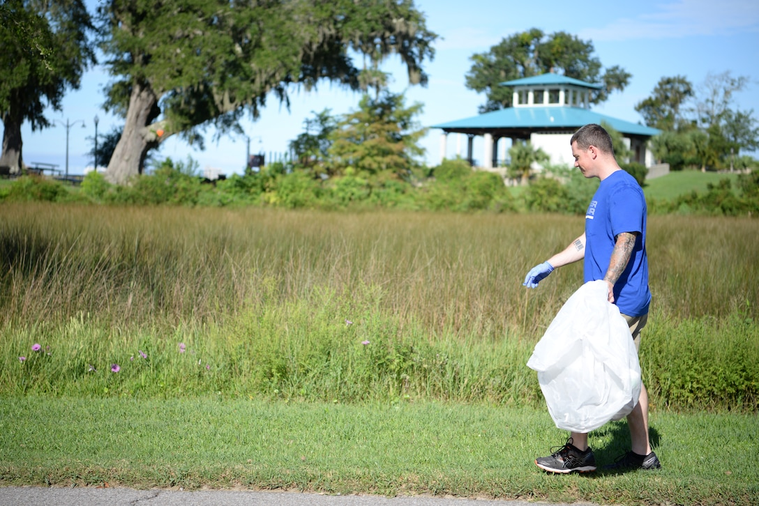 U.S Air Force Tech. Sgt. Sam Collings, Mathies NCO Academy student, looks for trash during the Community Clean-Up Day in Ocean Springs, Mississippi, Aug. 24, 2019. Volunteers coming from Ocean Springs and Keesler Air Force Base took to the streets of Ocean Springs to pick up trash around the city. (U.S Air Force photo by Airman 1st Class Spencer Tobler)