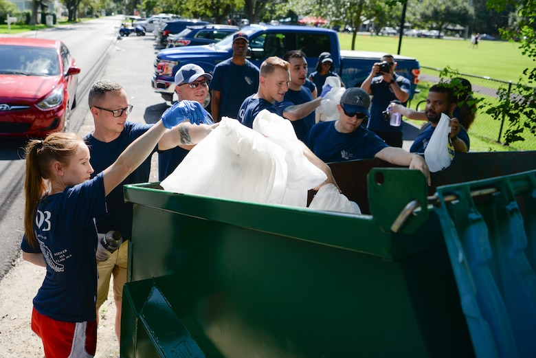 Volunteers from Matheis NCO Academy throw away trash during the Community Clean-Up Day in Ocean Springs, Mississippi, Aug. 24, 2019. Volunteers coming from Ocean Springs and Keesler Air Force Base took to the streets of Ocean Springs to pick up trash around the city. (U.S Air Force photo by Airman 1st Class Spencer Tobler)