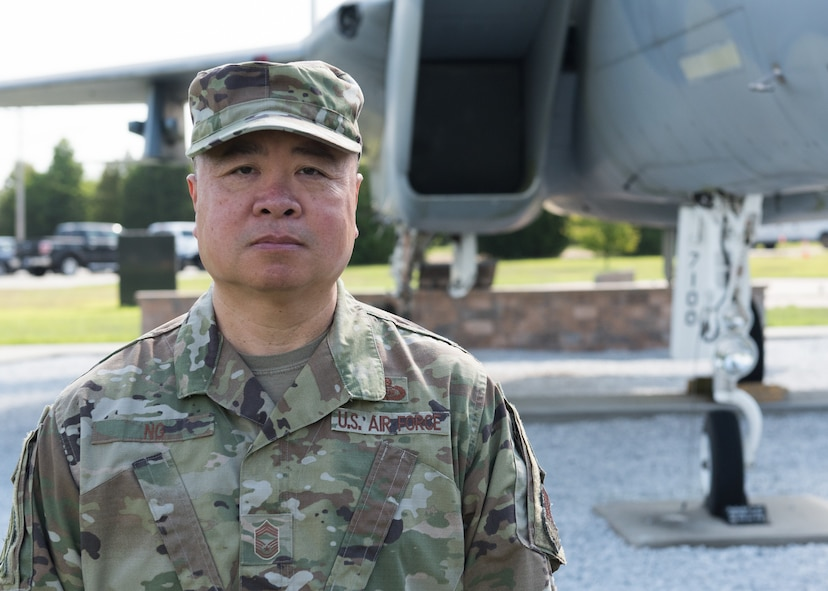 Chief Master Sgt. Wing Ng standing in front of an F-15A at Otis ANGB