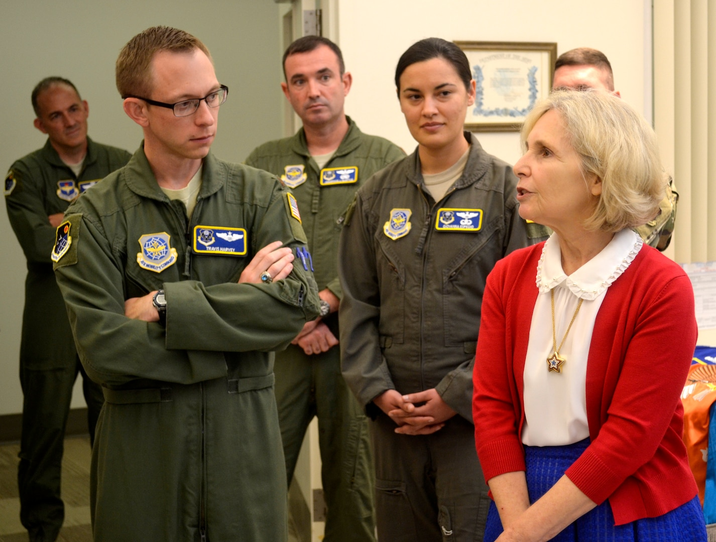 DLA Troop Support flag room supervisor Linda Farrell, right, speaks to students from the U.S. Air Force Expeditionary Operations School during a tour August 26, 2019 in Philadelphia. The students toured DLA to get an overview of the agency's services and mission.