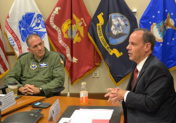 Navy Col. Adam Reiman, left, listens as Patrick Owens, right, deputy director of J3/5 Operations and Plans at DLA Troop Support, welcomes students from the U.S. Air Force Expeditionary Operations School to Philadelphia on August 26, 2019. The students met with representatives from each of DLA Troop Support's five supply chains.