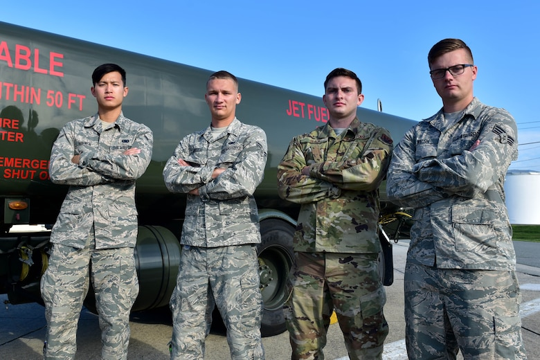 From left, Airman 1st Class Nathan Nguyen, Airman 1st Class Austin Herder, Senior Airman Charles Black and Senior Airman Robert Walsh, all assigned to the 4th Logistics Readiness Squadron fuels flight provided life-saving efforts to victims during a major vehicle accident near Seymour Johnson Air Force Base, North Carolina.