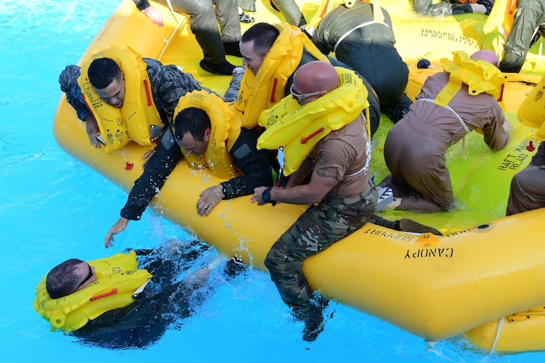 Airmen of the 758th Airlift squadron and the 911th Aeromedical Staging Squadron help each other on to a 46-man raft at during water survival training at Settler's Cabin Park in Pittsburgh, Pennsylvania, August 3, 2019. This is the first time the Airmen of the 758th Airlift squadron and the 911th Aeromedical Squadron are training on the C-17 Globemaster III aircraft safety equipment.