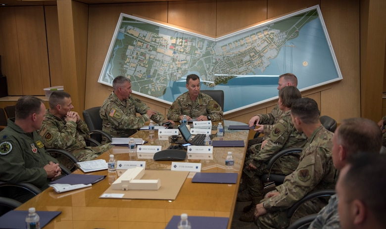 U.S. Air Force Maj. Gen. Chad Franks, center, Ninth Air Force commander, discusses hot topic items with base leadership during a visit at Joint Base Langley-Eustis, Virginia, August 26, 2019.