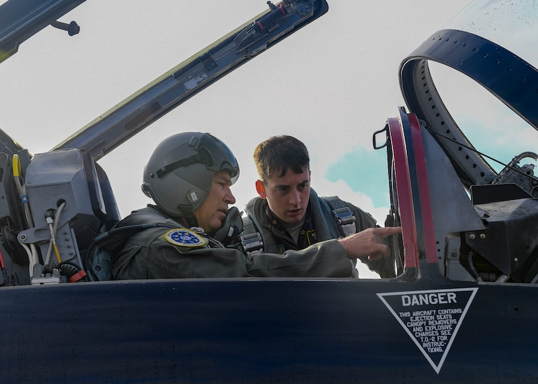 U.S. Air Force Maj. Gen. Chad Franks, Ninth Air Force commander, performs a pre-flight check with 1st Lt Michael Koon, 1st Fighter Wing flight safety officer prior to a T-38 Talon aircraft takeoff, August 28, 2019 at Joint Base Langley-Eustis, Virginia.