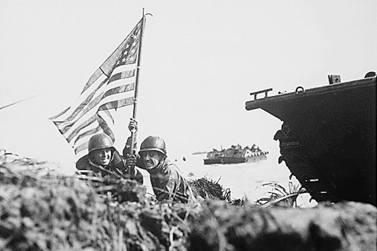Men hold U.S. flag.