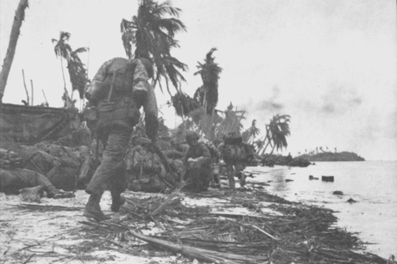 Marines move along beach.