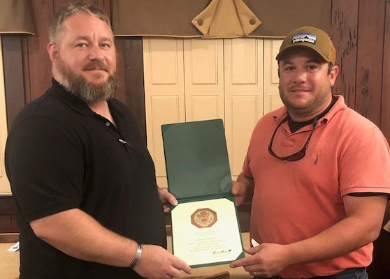 Daimon McNew (left) presents Ben Baddour with his Five Years Length of Service Certificate.